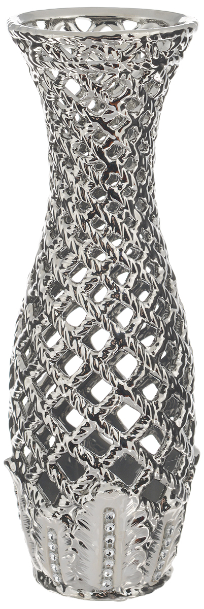 Ваза Sima-land Серебряная сетка, высота 28,5 смFS-91909Ажурная ваза Sima-land Серебряная сетка, изготовленная из высококачественной керамики, добавит в интерьер морозный лоск и деликатный шик. Дно изделия оснащено нескользящими накладками. В такой вазе эффектно будут смотреться композиции, выполненные из декоративных цветов. Любое помещение выглядит незавершенным без правильно расположенных предметов интерьера. Они помогают создать уют, расставить акценты, подчеркнуть достоинства или скрыть недостатки.