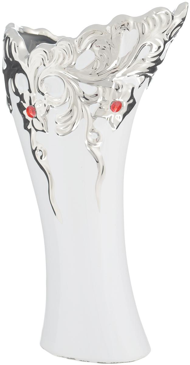 Ваза Sima-land Изумрудная капля, высота 30 смFS-91909Ваза Sima-land Изумрудная капля изготовлена из высококачественной керамики и декорирована стразами. Интересная форма и необычное оформление сделают эту вазу замечательным украшением интерьера. Ваза предназначена как для живых, так и для искусственных цветов. Любое помещение выглядит незавершенным без правильно расположенных предметов интерьера. Они помогают создать уют, расставить акценты, подчеркнуть достоинства или скрыть недостатки.