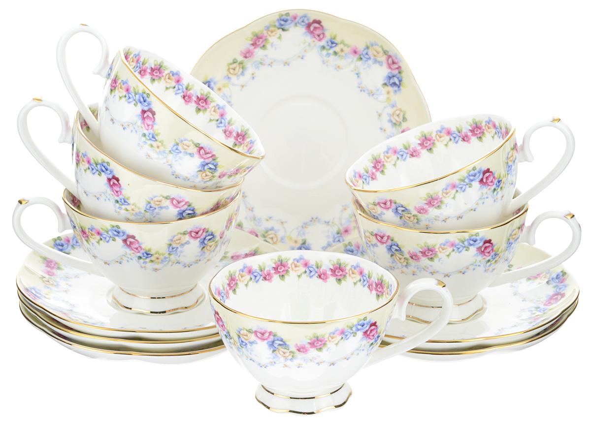 Чайный набор Elan Gallery Гирлянда из роз, 12 предметов115510Чайный набор Elan Gallery Гирлянда из роз состоит из 6 чашек и 6 блюдец. Изделия, выполненные из высококачественной керамики, имеют элегантный дизайн и классическую форму.Такой набор прекрасно подойдет как для повседневного использования, так и для праздников. Чайный набор Elan Gallery Гирлянда из роз - это не только яркий и полезный подарок для родных и близких, а также великолепное решение для вашей кухни или столовой. Не использовать в микроволновой печи.Объем чашки: 250 мл. Диаметр чашки (по верхнему краю): 10 см. Высота чашки: 6,5 см.Диаметр блюдца (по верхнему краю): 16 см.Высота блюдца: 2 см.
