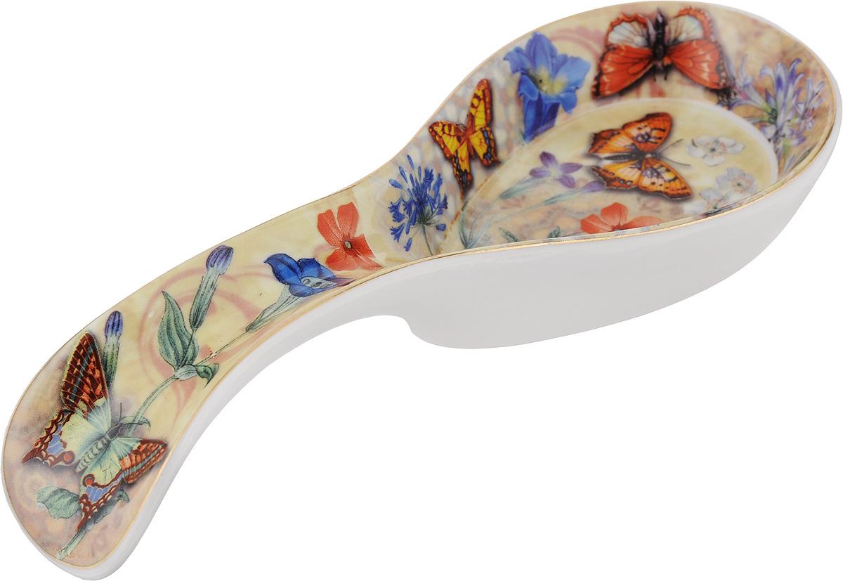 Подставка под ложку Loraine Бабочки, длина 21 см. 246114724Подставка под ложку Loraine Бабочки изготовлена из высококачественной керамики. Изделие декорировано красочным изображением цветов. Подставка под ложку - очень удобный и полезный аксессуар на вашей кухне. Она поможет поддерживать чистоту на столе во время приготовления пищи, теперь есть куда положить ложку, которой вы помешиваете блюда. Подставка под ложку украсит кухонный стол, а также станет замечательным подарком для ваших друзей и близких.