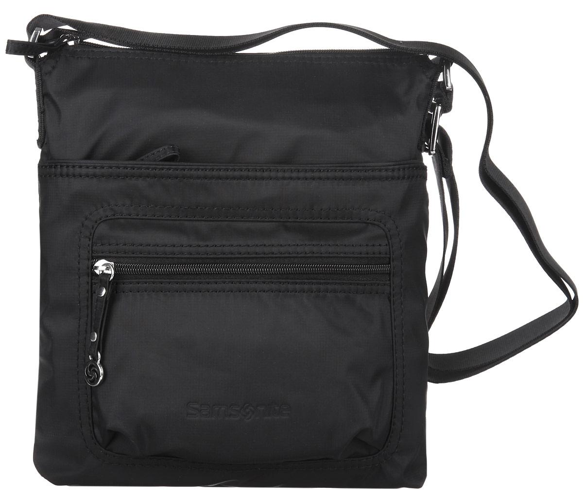 Сумка женская Samsonite, цвет: черный. 5H3-09128L39845800Стильная женская сумка Samsonite выполнена из полиамида, оформлена металлической фурнитурой и символикой бренда.Изделие содержит одно отделение, закрывающееся на застежку-молнию. Внутри сумки расположены два накладных кармашка для мелочей, врезной карман на застежке-молнии, карабин для ключей и мягкий карман для планшета. На лицевой стороне изделия расположен вместительный накладной карман на молнии и дополнительный кармашек на молнии. Изделие оснащено практичным плечевым ремнем регулируемой длины.Практичный аксессуар позволит вам завершить образ и быть неотразимой.