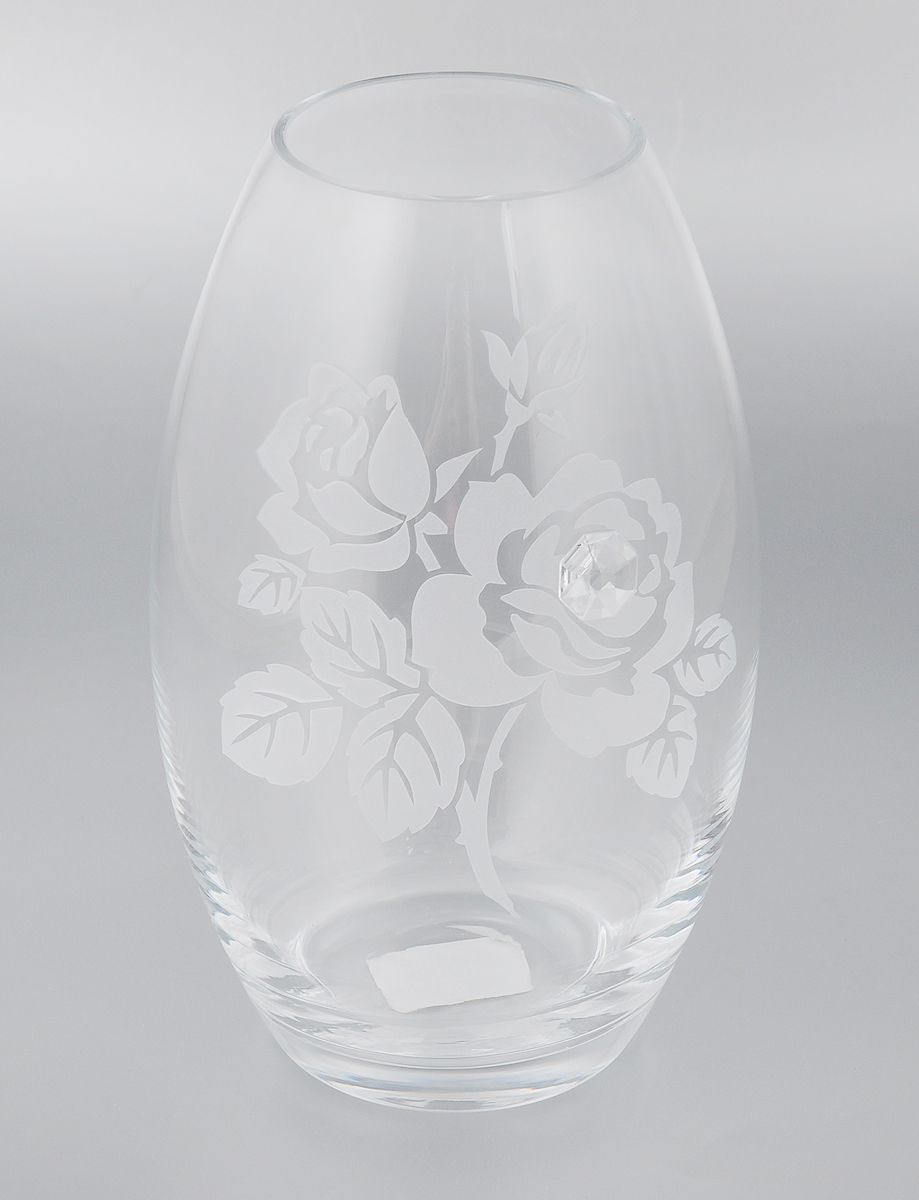 Ваза Deco Glass Роза, высота 23,5 смFS-91909Ваза Deco Glass Роза ручной работы, выполненная из прозрачного стекла, оформлена гравировкой в виде цветов и декорирована изящным кристаллом. Вазу можно использовать как декоративный элемент, поставить в нее букет прекрасных цветов или декоративных веточек. Нарядная и утонченная ваза Deco Glass Роза станет великолепным подарком на любой праздник.Диаметр вазы (по верхнему краю): 8,5 см.Высота вазы: 23,5 см.