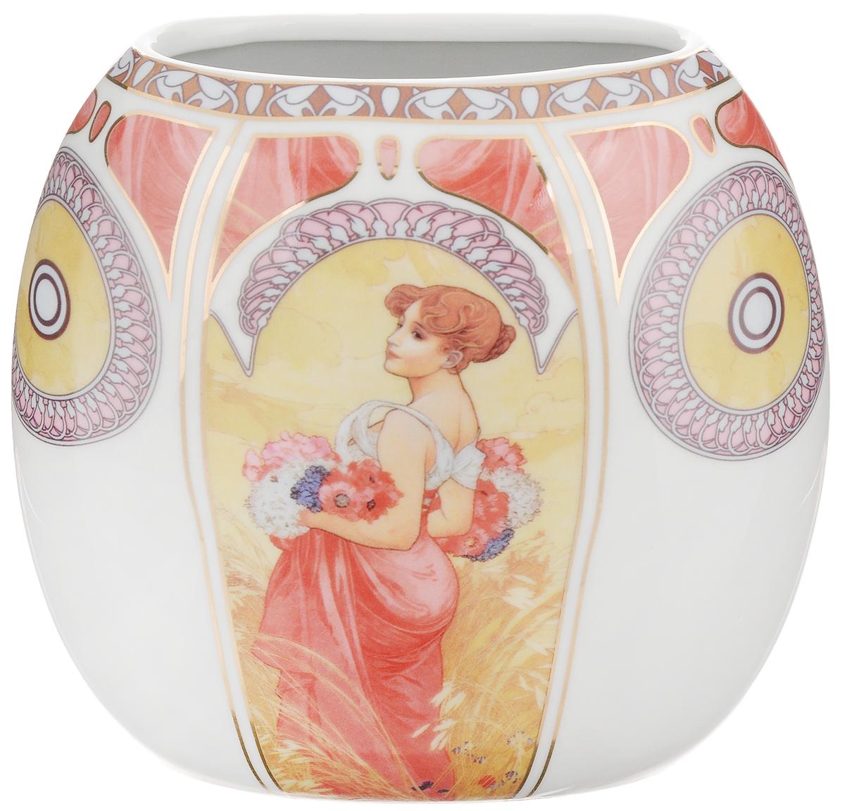 Ваза Elan Gallery Лето, высота 15 смFS-80423Декоративная ваза Elan Gallery Лето украсит ваш интерьер и будет прекрасным подарком для ваших близких! Она подойдет для небольших букетиков цветов или сухоцветов. Изделие выполнено из высококачественного фарфора и украшено ярким рисунком. Оригинальный дизайн наполнит ваш дом праздничным настроением. Такая ваза станет желанным подарком для ваших близких!Размер вазы по верхнему краю: 11 х 5,5 см.Размер дна: 11 х 5,5 см.Высота вазы: 15 см.