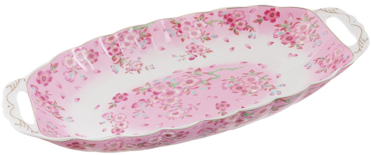 Блюдо для горячего Elan Gallery Сакура, 42 х 22,5 х 5,5 смFS-91909Блюдо для горячего Elan Gallery Сакура, изготовленное из керамики,станет украшением вашего праздничного стола. Изделие подходит для подачигорячего или шашлыка. В такой посуде можноприготовить блюдо и, не перекладывая на другую тарелку, подать его стол.Благодаря двум ручками его удобно переносить.Красочность оформления придется по вкусу тем, кто предпочитает утонченностьи изящность. Не рекомендуется применять абразивные моющие средства.Не использовать в микроволновой печи.Объем блюда: 1,5 л.