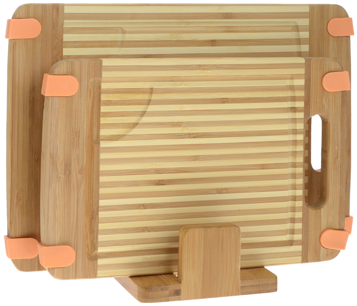 Набор разделочных досок Mayer & Boch, на подставке, 2 шт. 2259054 009312Набор Mayer & Boch состоит из двух прямоугольных разделочных досок и подставки. Изделия выполнены из экологически чистого бамбука. Бамбук является возобновляемым ресурсом, что делает его безопасным для использования. Не содержит красителей - перманентная краска не выцветает и не смывается. Бамбук впитывает влагу в маленьких количествах и обладает естественными антибактериальными свойствами. Доски отлично подходят для приготовления и измельчения пищи, а также для сервировки стола. Специальные силиконовые накладки предотвращают скольжение. Доски снабжены ручкой для комфортного использования, а также выемками по краю для стока жидкости. Такой набор станет практичным и полезным приобретением для вашей кухни. Размер досок: 35 х 25 х 1,6 см; 30 х 20 х 1,6 см. Размер подставки: 15 х 13 х 6 см.
