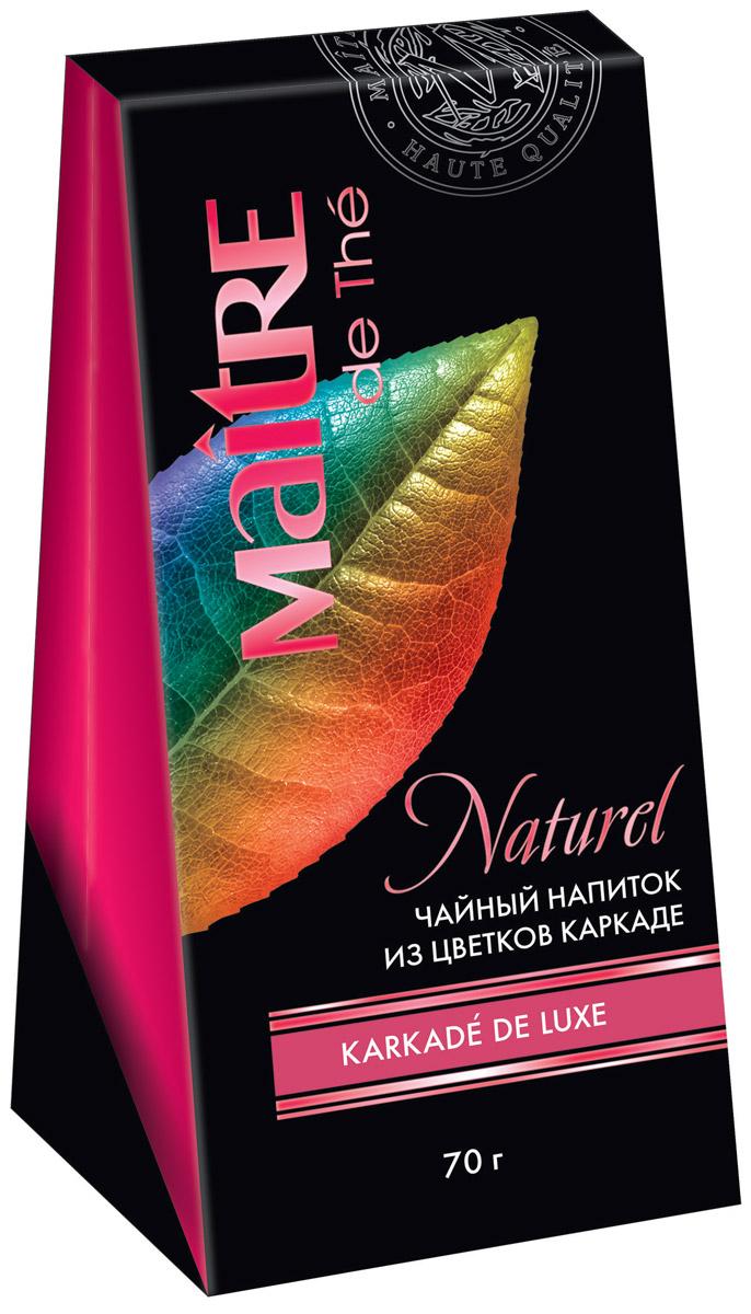 Maitre Karkade de Luxe чайный напиток каркаде, 70 г0120710Отборные целые лепестки и подчашия цветков каркаде (гибискуса). Настой каркаде кисло-сладкий, прозрачный, густого малинового цвета, не содержит кофеин. Горячий напиток прекрасно охлаждает в жару, в холодное время идеален с сахаром.