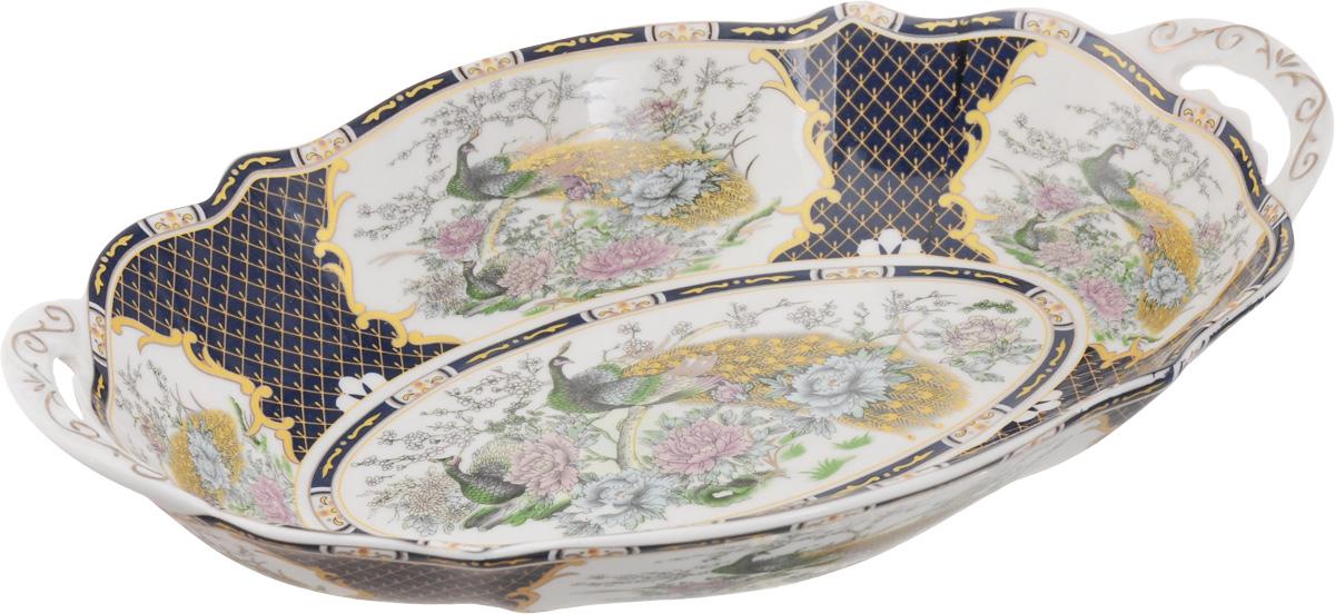 Блюдо Elan Gallery Павлин на золоте, 28 х 19 х 4,5 см115510Блюдо Elan Gallery Павлин на золоте станет изысканным украшением вашего праздничного стола. Изделие выполнено из высококачественной керамики и декорировано красивым рисунком и золотистой эмалью. Размер этого блюда подходит для подачи горячего или шашлыка, а две ручки помогут при подаче на стол. Не использовать в микроволновой печи.Размер блюда (с учетом ручек): 28 х 19 х 4,5 см.