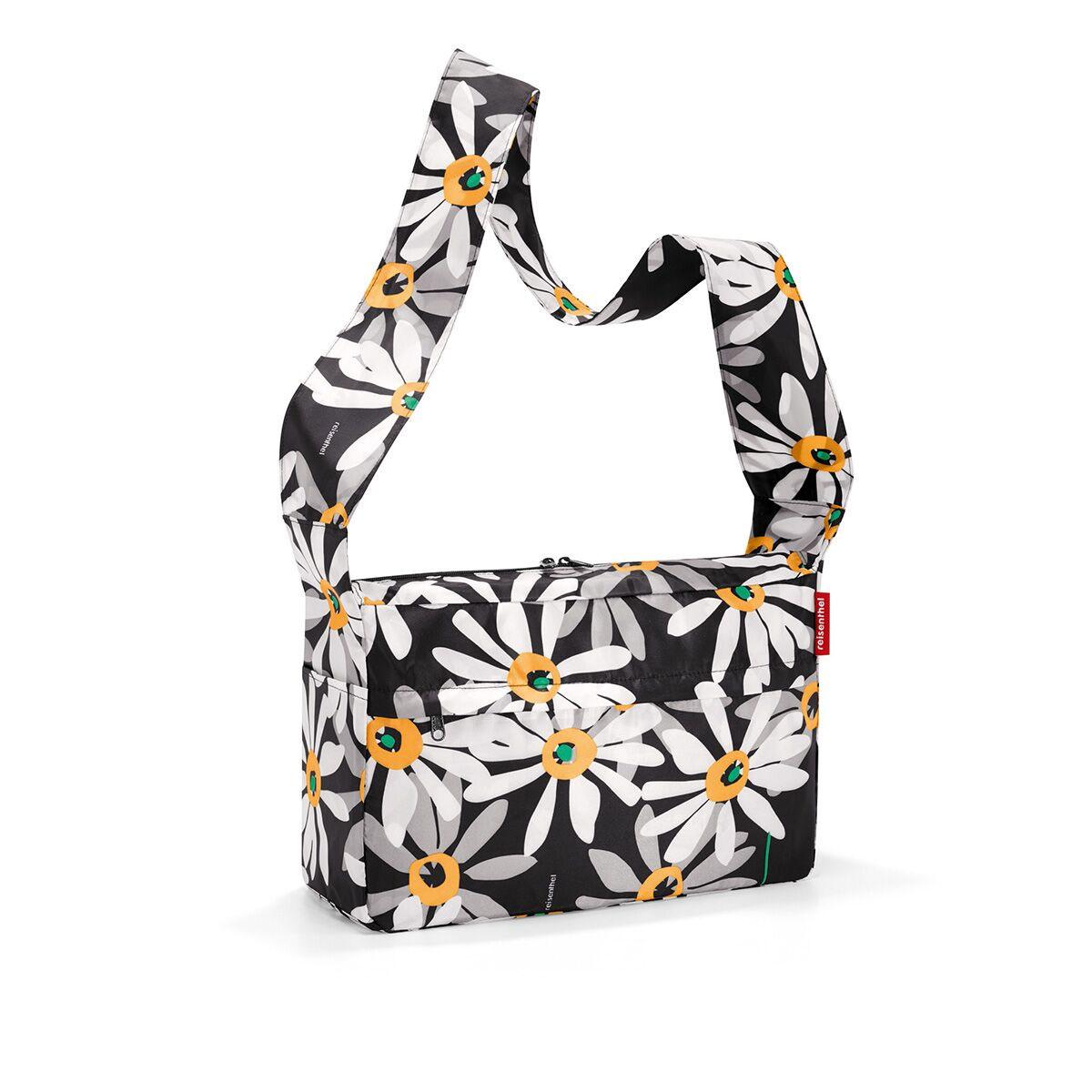 Сумка женская Reisenthel, складная, цвет: черный, серый, белый. AL7038L39845800Стильная женская сумка Reisenthel изготовлена из текстиля с цветочным принтом. Сумка имеет одно отделение, которое закрывается на застежку-молнию с двумя бегунками. Внутри имеется нашивной карман на застежке-молнии, в который сумка складывается и приобретает компактный вид. Снаружи, на передней стенке расположен накладной карман на застежке-молнии. По бокам расположены открытые накладные карманы. Изделие оснащено удобным наплечным ремнем.