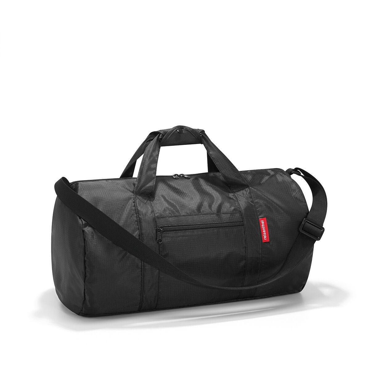 Сумка спортивная женская Reisenthel, цвет: черный. AM7003KLF256Универсальная сумка-трансформер серии Mini Maxi, предназначенная для путешествий и спорта. Подходит для хранения, компактно складывается в собственный внутренний карман. У модели вместительное основное отделение на молнии, экономит место при хранении и перевозке в сложенном состоянии, регулируемый наплечный ремень, ручки для переноски, регулируемые при помощи специальных застежек, два внешних кармана на молнии, материал: высококачественный водостойкий полиэстер, объем - 20 литров.