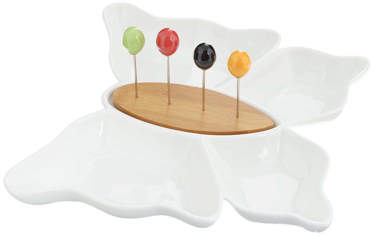 Менажница Elan Gallery Бабочка, со шпажками, 4 секцииFS-91909Менажница Elan Gallery Бабочка, изготовленная из высококачественной керамики. Менажница состоит их 4 секций и предназначена для подачи сразу нескольких видов закусок, нарезок или соусов. В комплект также входят четыре разноцветные шпажки, которые вставляются в деревянную подставку.Менажница Elan Gallery Бабочка станет настоящим украшением праздничного стола и подчеркнет ваш изысканный вкус. Не рекомендуется примен\ть абразивные моющие средства.Не использовать в микроволновой печи.Общий размер менажницы: 28,5 х 26,5 х 4 см.Размер секций: 18 х 11 х 3 см; 12 х 10 х 3 см.Длина шпажки: 8,5 см.Размер подставки: 15 х 5,5 х 1 см.