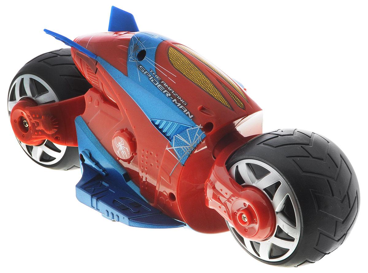 """Мотоцикл на радиоуправлении Majorette """"Человек-паук. Cyber Cycle"""" не оставит равнодушным вашего ребенка. Мотоцикл выполнен в стиле Человека-паука из красно-синего пластика и оформлен изображениями паука и паутины. Он оснащен двумя широкими колесами. Шины изготовлены из мягкой резины. Модель при помощи пульта управления может двигаться вперед, назад, поворачивать влево и вправо, разворачиваться и останавливаться. Пульт управления работает на частоте 27 MHz. Ваш ребенок часами будет играть с моделью, придумывая различные истории и устраивая соревнования. Порадуйте его таким замечательным подарком! Мотоцикл работает от 5 батареек типа АА (входят в комплект). Пульт управления работает от батарейки типа """"Крона"""" (входит в комплект)."""