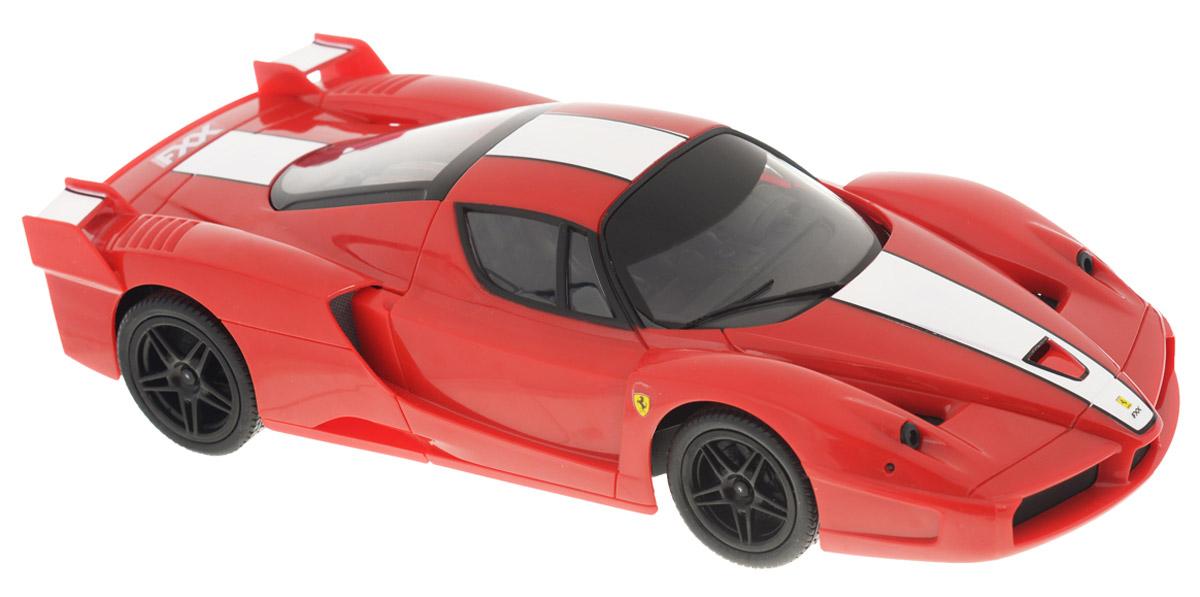 """Радиоуправляемая модель Silverlit """"Ferrari FXX """" обязательно привлечет внимание взрослого и ребенка и, несомненно, понравится любому, кто увлекается автомобилями. Маневренный и реалистичный автомобиль Ferrari FXX выполнен в точной детализации с настоящим автомобилем. В набор входит сам автомобиль в масштабе 1 к 16, пульт дистанционного управления и инструкция на русском языке. Машинка двигается вперед и назад, поворачивает направо и налево и может резко остановиться. Игрушка от Silverlit оснащена световыми спецэффектами - у нее светятся фары, горят поворотные огни и стоп-сигналы. При движении машинки фары можно отключить с помощью пульта. Стоит лишь ребенку нажать кнопку на пульте, как у автомобиля загорятся фары, а его мотор будет издавать характерные звуки. Машинка может разгоняться до 20 км в час, но даже на этой скорости прекрасно входит во все повороты. У игрушки колеса прорезинены, поэтому она обеспечивает плавный ход игрушки и не портит напольное покрытие. ..."""