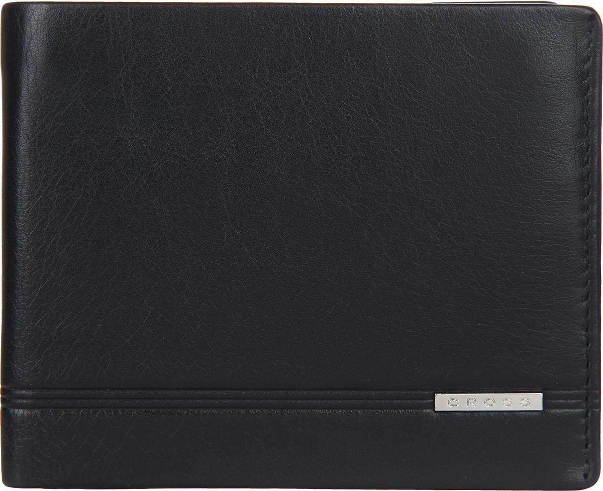 Кошелек мужской Cross, цвет: черный. AC018363-1490300нСтильный мужской кошелек Cross изготовлен из натуральной кожи и оформлен металлической пластиной с символикой бренда.Изделие раскладывается пополам. Внутри расположены два прорезных потайных кармана, два отделения для купюр, четыре кармана для кредитных карт. Кошелек оснащен откидным блоком, который включает в себя два кармашка с прозрачными вставками и карман для пластиковой кары. Снаружи, на задней стороне, изделия расположен дополнительный прорезной кармашек. Изделие поставляется в фирменной упаковке.Практичный кошелек непременно подойдет к вашему образу, а также порадует простотой, стилем и функциональностью.