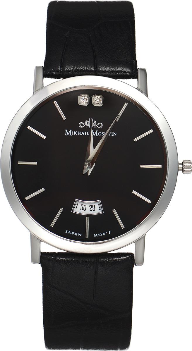 Часы наручные мужские Mikhail Moskvin, цвет: серебряный, черный. 1014S0L4BM8434-58AEЭлегантные мужские часы Mikhail Moskvin изготовлены из нержавеющей стали и минерального стекла. Циферблат изделия оформлен символикой бренда и инкрустирован двумя кристаллами.Корпус часов имеет степень влагозащиты, равную 3 Bar, оснащен кварцевым механизмом, а также устойчивым к царапинам минеральным стеклом. Циферблат оснащен индикатором даты. Ремешок, выполненный из натуральной кожи с декоративным тиснением, застегивается на практичную пряжку.Часы поставляются в фирменной упаковке.Часы Mikhail Moskvin подчеркнут отменное чувство стиля их обладателя.