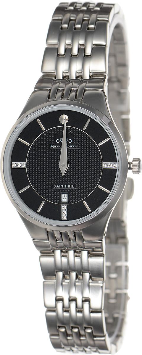 Часы наручные женские Mikhail Moskvin Elegance, цвет: серебряный, черный. L5001S0B14106черныеСтильные женские наручные часы Mikhail Moskvin из серии Elegance изготовлены из высокотехнологичной гипоаллергенной нержавеющей стали. Для того чтобы защитить циферблат от повреждений в часах используется высокопрочное сапфировое стекло. Циферблат изделия оснащен гранеными стрелками, оформлен символикой бренда и стразами.Корпус часов оснащен кварцевым японским механизмом, степенью влагозащиты равной 3 Bar, а также календарем, показывающим число месяца. Браслет часов застегивается на замок-клипсу, который позволит с легкостью снимать и надевать часы.Часы упакованы в фирменную коробку и дополнительно в текстильную сумку с названием бренда.Часы Mikhail Moskvin подчеркнут характер и отменное чувство стиля их обладателя.