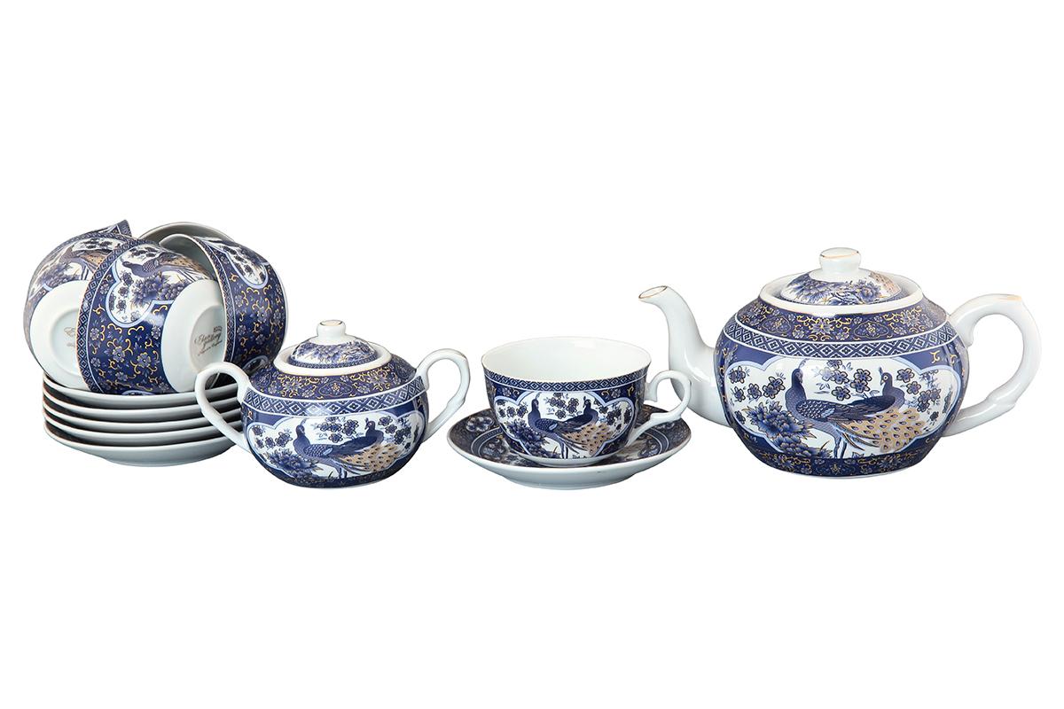 Чайный набор Elan Gallery Павлин, 14 предметов. 730501VT-1520(SR)Чайный сервиз на 6 персон из традиционной коллекции Павлин синий - неотъемлемый атрибут чаепития и служит не только посудой, но и источником эстетического наслаждения. Изделие имеет подарочную упаковку, идеальный подарок для ваших близких! Чашки -250 мл., сахарница - 400 мл., чайник - 900 мл. Размеры: 60x110x95 мм, 140x140x20 мм.