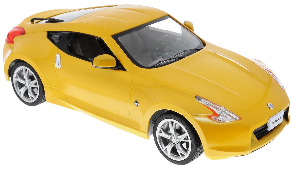 """Радиоуправляемая модель Rastar """"Nissan 370Z"""" - яркая реалистичная модель автомобиля в масштабе 1:14! Игрушка выполнена из безопасного пластика. Колеса машинки прорезинены, что обеспечивает плавный ход, игрушка не портит напольное покрытие. Управление машинкой происходит с помощью пульта. Движение автомобиля: вперед-назад, поворот направо, поворот налево, стоп. Автомобиль обладает световыми эффектами. Радиоуправляемые игрушки способствуют развитию координации движений, моторики и ловкости. Ваш ребенок часами будет играть с машиной, придумывая различные истории и устраивая соревнования. Машина работает от 5 батареек типа АА (не входят в комплект). Пульт управления работает от батарейки 9V типа """"Крона"""" (не входит в комплект)."""