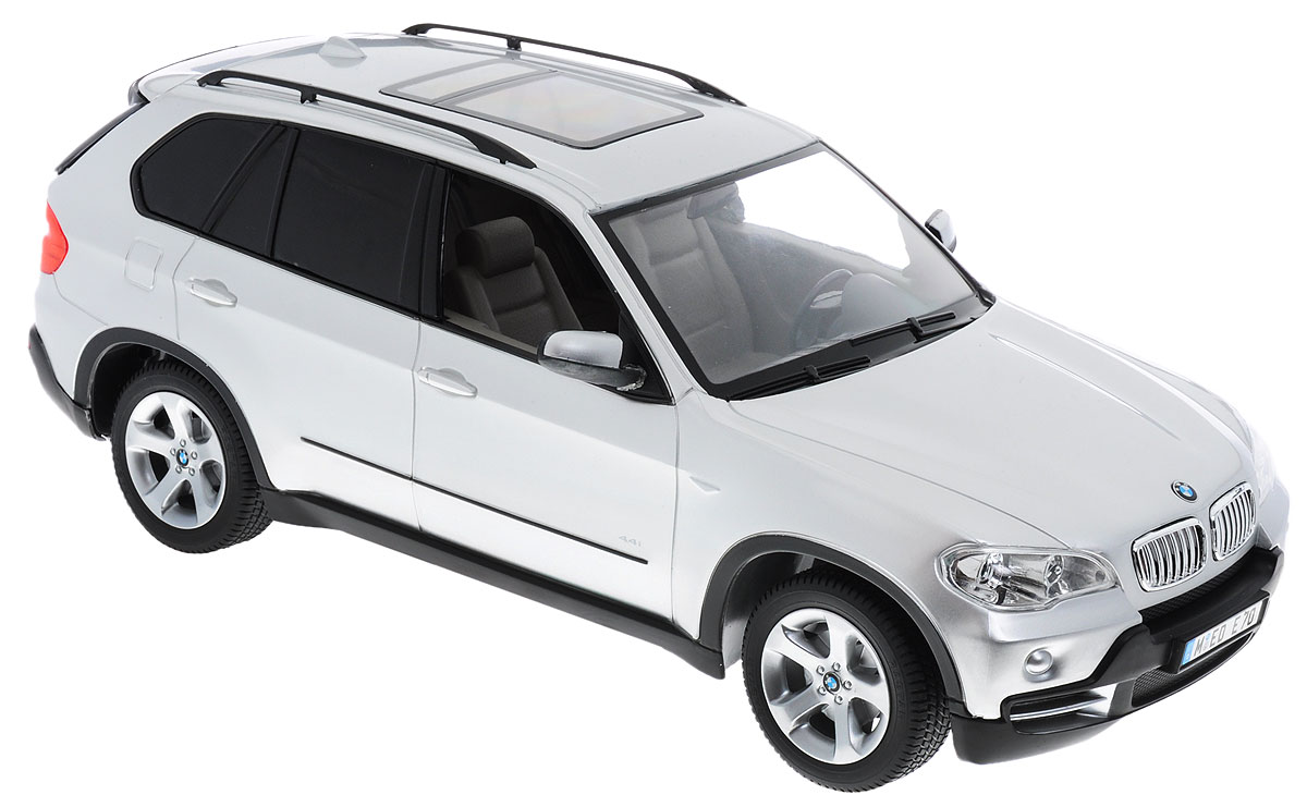 """Радиоуправляемая модель Rastar """"BMW X5"""" предназначена для тех, кто любит роскошь и высокие скорости. Изделие выполнено из пластика с использованием металлических элементов. Это авто обладает неповторимым провокационным стилем и спортивным характером. Автомобиль отличается потрясающей маневренностью, динамикой и покладистостью. Выполнена машина в точной детализации с настоящим автомобилем в масштабе 1:14. Управление машинкой происходит с помощью пульта. Машина двигается вперед и назад, поворачивает направо, налево и останавливается. Имеются световые эффекты. Пульт управления работает на частоте 27 MHz. Колеса игрушки прорезинены и обеспечивают плавный ход, машинка не портит напольное покрытие. Радиоуправляемые игрушки способствуют развитию координации движений, моторики и ловкости. Ваш ребенок часами будет играть с моделью, придумывая различные истории и устраивая соревнования. Порадуйте его таким замечательным подарком! Машина работает от..."""