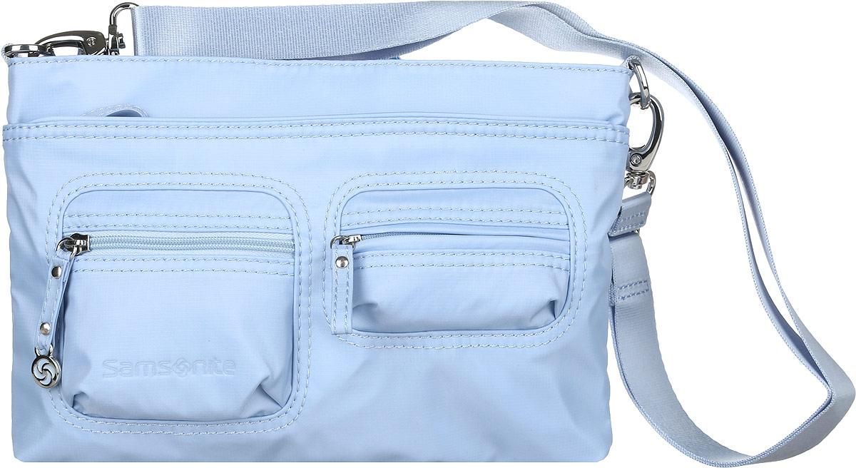 Сумка женская Samsonite, цвет: голубой. 5H3*3105871069с-2Стильная и практичная женская сумка Samsonite выполнена из полиамида. Изделие имеет одно основное отделение, закрывающееся на застежку-молнию. Внутри находятся мягкий карман для планшета с диагональю 9.7, два накладных открытых кармана и текстильный ремешок с карабином для ключей. Снаружи, на передней стенке расположены накладной карман на застежке-молнии и два накладных объемных кармана на застежках-молниях, на задней стенке - дополнительный накладной карман на застежке-молнии. Модель оснащена съемным регулируемым плечевым ремнем. Стильная сумка позволит вам завершить образ.