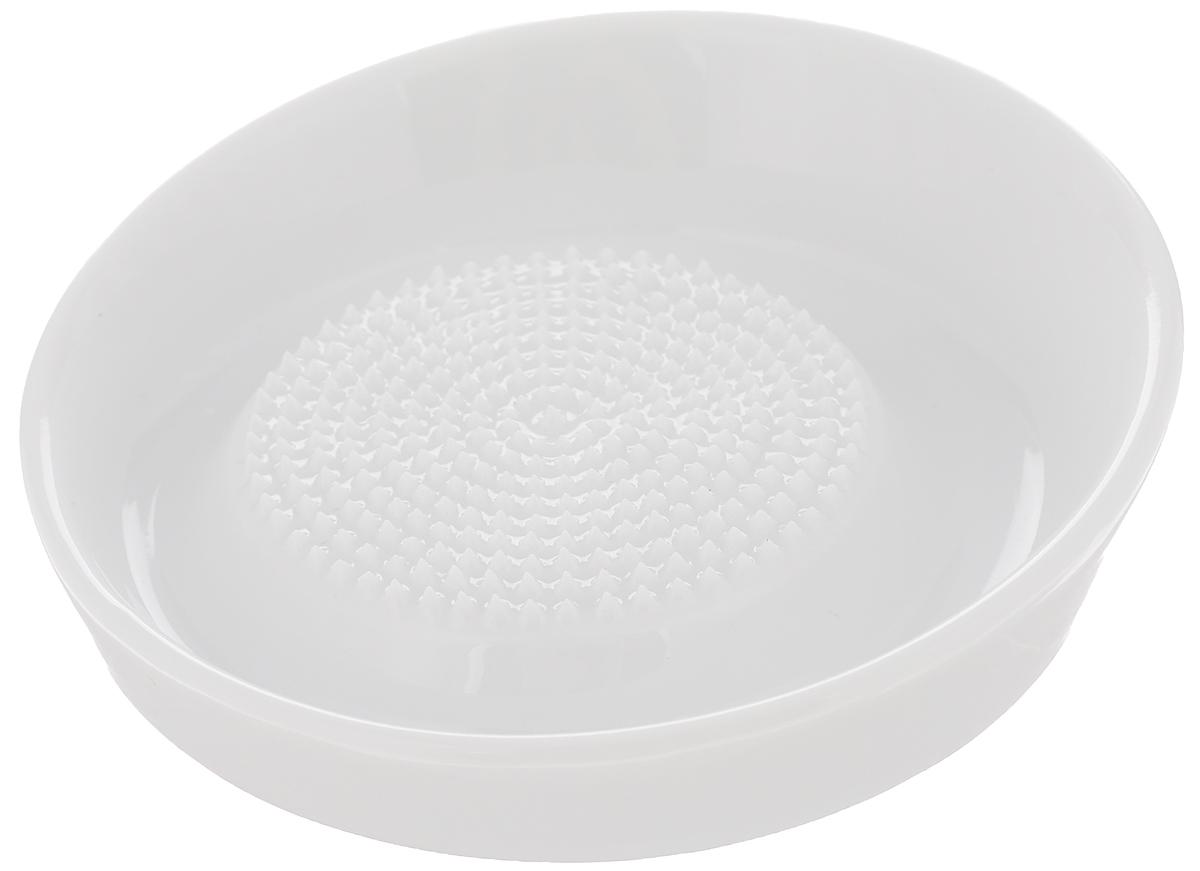 Терка Tescoma Online, диаметр 10 см3510456Терка Tescoma Online выполнена из высококачественного фарфора и замечательно подходит для растирания чеснока, имбиря, морковки. Основание терки оснащено резиновыми вставками, что предотвращает ее скольжение при использовании. Можно использовать в морозильнике.Можно мыть в посудомоечной машине.