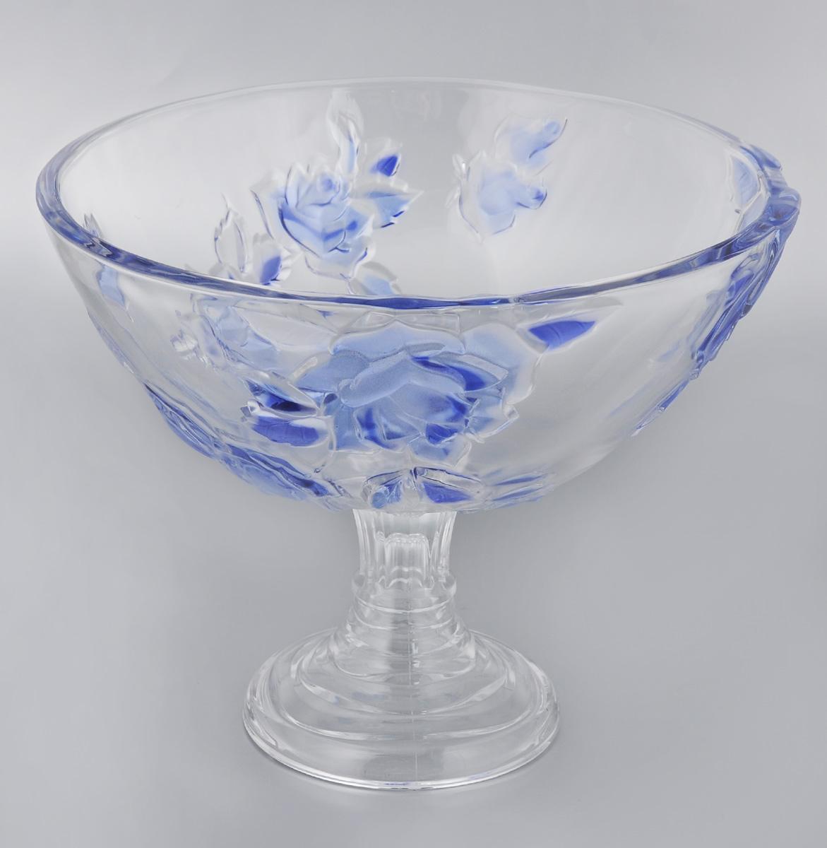 Конфетница Soga Rosette Blue, диаметр 28 см115510Элегантная конфетница Soga Rosette Blue на ножке, изготовленная из прочного стекла, имеет многогранную рельефную поверхность. Конфетница предназначена для красивой сервировки сладостей. Изделие придется по вкусу и ценителям классики, и тем, кто предпочитает утонченность и изящность. Конфетница Soga Rosette Blue украсит сервировку вашего стола и подчеркнет прекрасный вкус хозяина, а также станет отличным подарком.Можно мыть в посудомоечной машине.