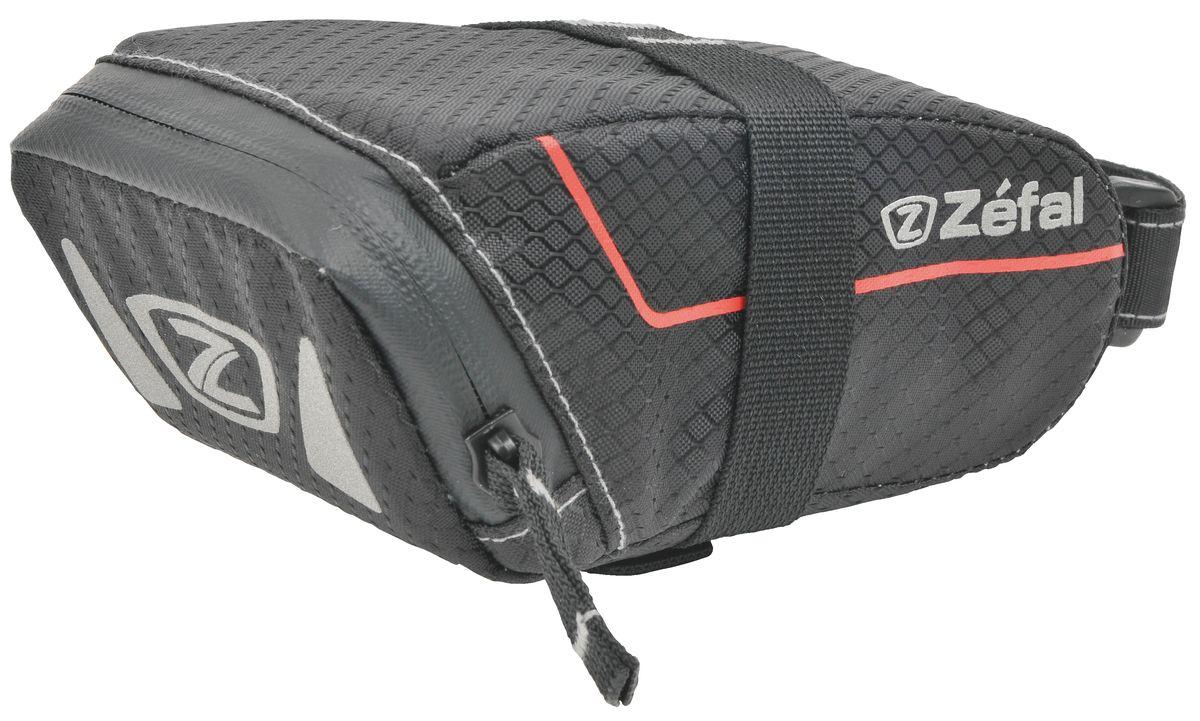 Подседельная сумка Zefal Z Light Pack S, цвет: черныйZ90 blackПодседельная сумка для велосипеда Zefal Z Light Pack S изготовлена из высококачественного текстиля (полиэстер). Прорезиненная молния защиты от попадания влаги внутрь. Легкая и быстрая установка на подседельный штырь и рамки седла. Zefal – старейший французский производитель велосипедных аксессуаров премиального качества, основанный в 1880 году, является номером один на французском рынке велосипедных аксессуаров. ОСОБЕННОСТИ: - Сумка изготовлена из полиэстера - Водонепроницаемая молния- Крепление на душки седла