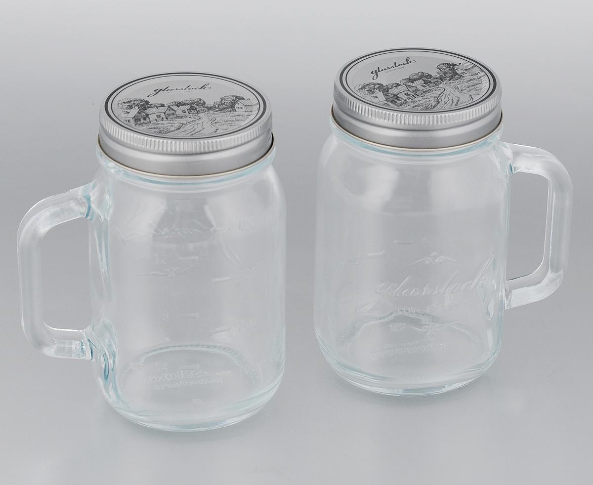 Набор банок для сыпучих продуктов Glasslock, цвет: серебристый, прозрачный, 500 мл, 2 штFA-5125 WhiteБанки для хранения Glasslock, изготовленные из прочного прозрачного стекла, оснащены металлическими крышками и удобными ручками. На стенках имеется мерная шкала. Изделия подходят для варенья, специй, чая, кофе, круп, сахара и соли и многого другого, а также напитков.Такие банки стильно дополнят интерьер кухни и помогут эффективно организовать пространство.Изделия не подходят для микроволновой печи и духовки. Диаметр банки (по верхнему краю): 7 см.Высота банки (с учетом крышки): 13,5 см.