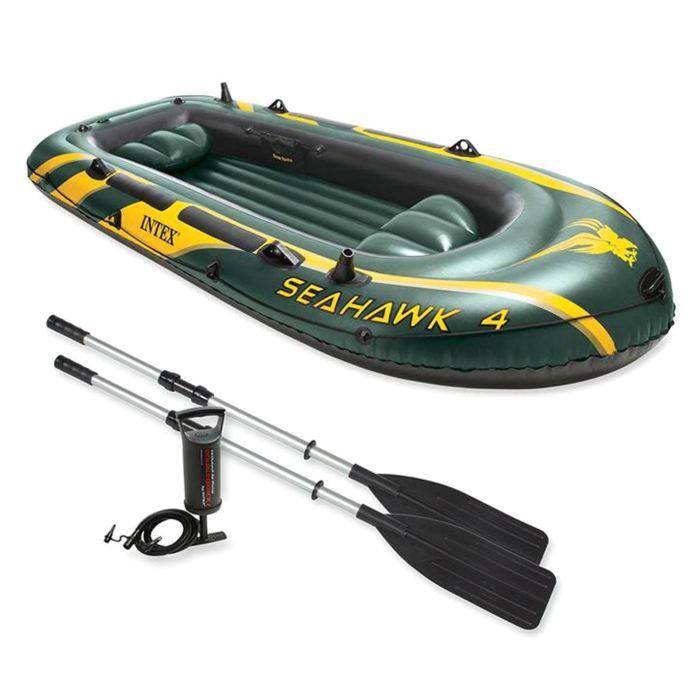 Лодка Intex Seahawk 4, цвет: зеленый. 68351NP302100Лодка Intex состоит из абсолютно независимых трех воздушных отсеков. Каждый отсек имеет клапан для быстрого скачивания и надувания лодки. Основной, внешний отсек придает лодке форму. Внутренние отсеки создают жесткость лодки на плаву и обеспечивают пассивную безопасность, в случае повреждения основного отсека. Надувной пол обеспечивает дополнительный комфорт нахождения внутри изделия. Для удобства конструкция надувного пола сделана волнистой, поперек бортам лодки. Лодка имеет крепления для весел и две лодочные уключины. На носу имеется пластиковая ручка, для переноса лодки или спуска на воду. Вокруг внешней камеры лодки находится веревочный трос, его можно использовать как для буксировки лодки, так и для швартования.Лодка Seahawk 4 четырехместная до 400 кг 351х145х48 см (в комплекте: весла, насос)