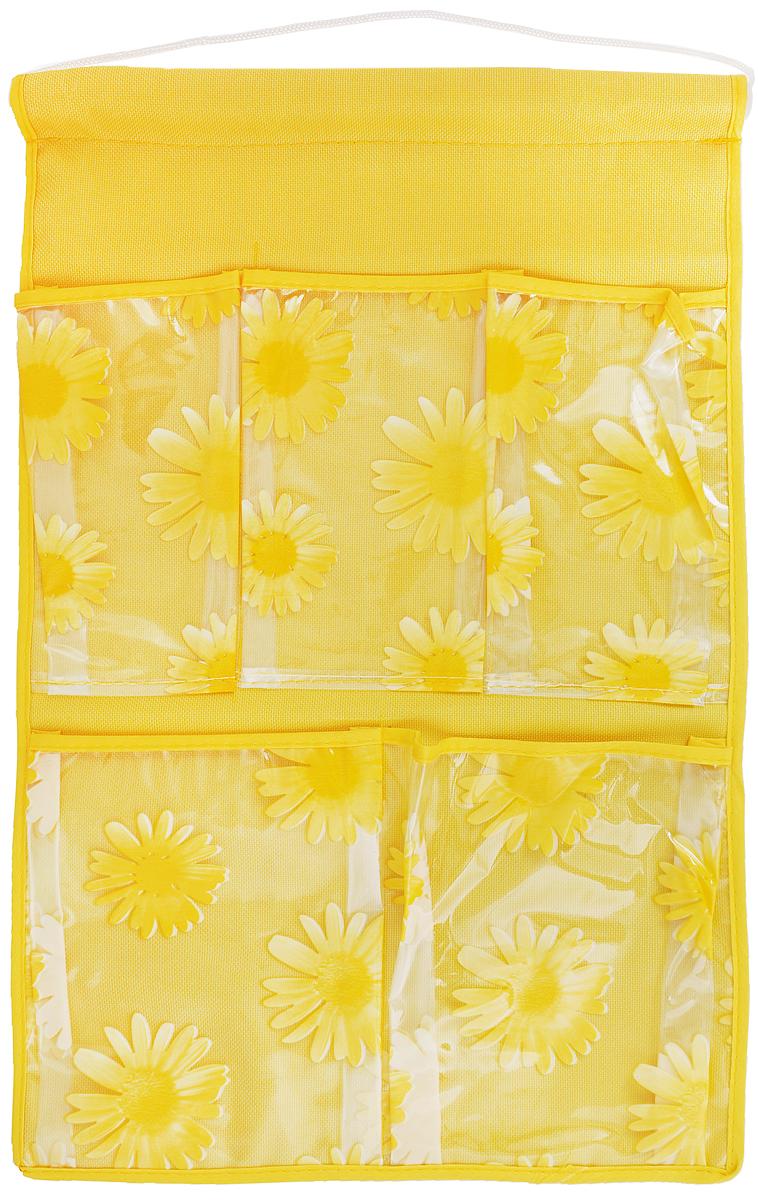Кармашки на стену Sima-land Герберы, цвет: желтый, 5 отделений74-0060Кармашки на стену Sima-land Герберы, изготовленные из текстиля, предназначены для хранения необходимых вещей, множества мелочей в гардеробной, ванной или детской. Изделие представляет собой полотно с 5 пришитыми кармашками из ПВХ, декорированные изображением цветов. Благодаря пластиковой трубке и шнурку, кармашки можно подвесить на стену или дверь в необходимом для вас месте. Этот нужный предмет может стать одновременно и декоративным элементом комнаты. Размеры кармашков: 9 х 16 см; 9,5 х 16 см; 13,5 х 17 см; 14 х 17 см.