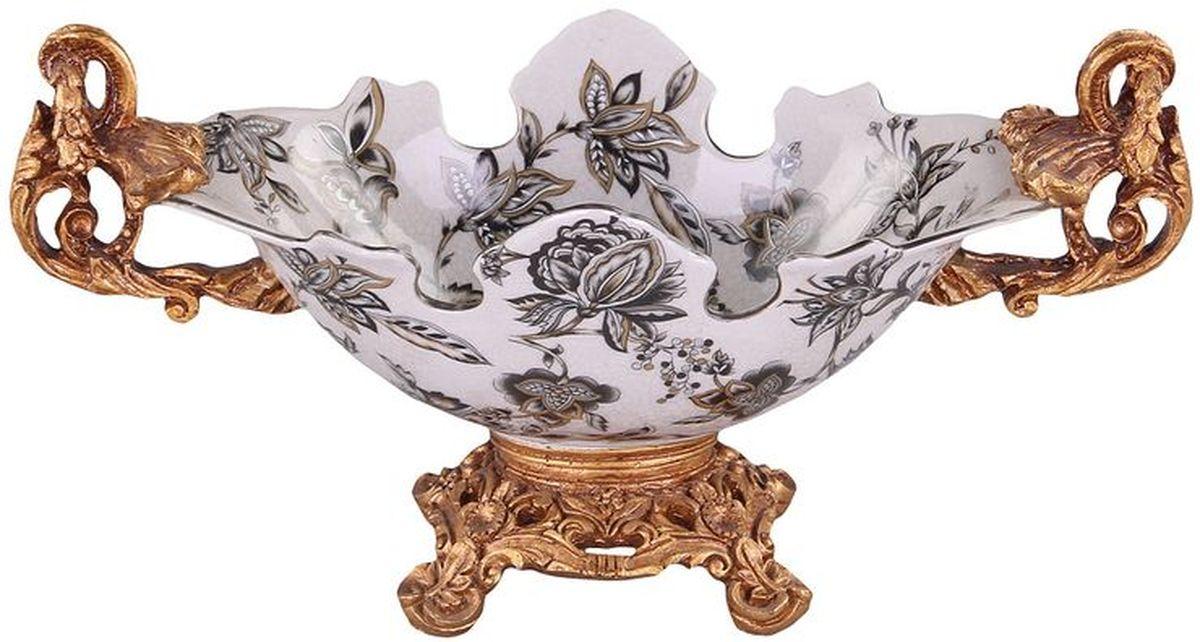 Фруктовница на ножке 33 см PATRICIAVT-1520(SR)Фруктовница на ножке выполнена из керамики. Изделие имеет сложную форму напоминающую распустившийся бутон цветка. Подставка изготовлена из полимерного материала имитирующего бронзу. Вся поверхность изделия украшена цветочным декором в классическом стиле.