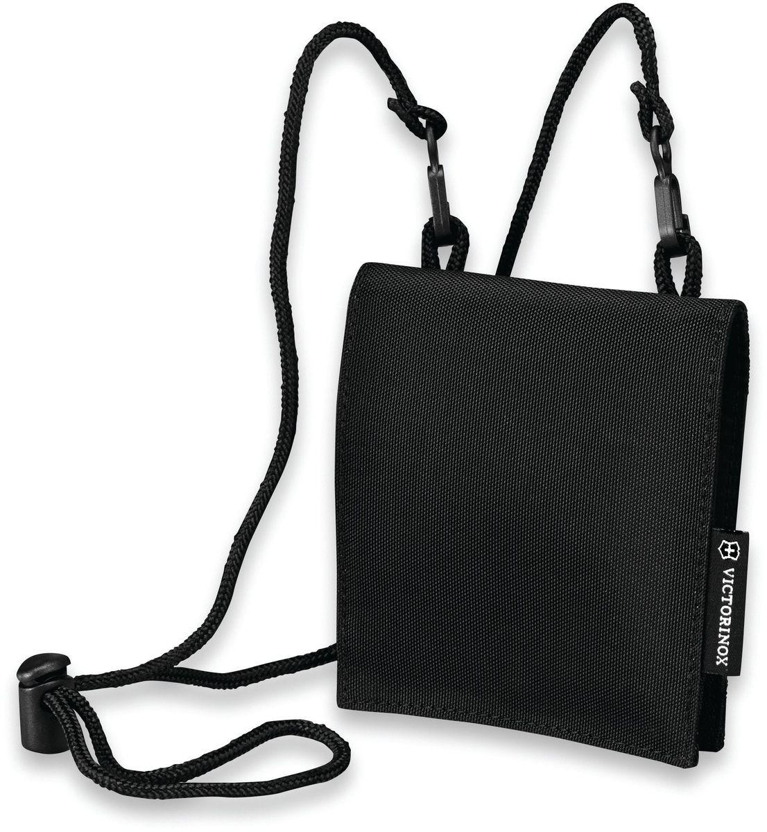 Кошелек на шею Victorinox Convertible Travel Wallet, цвет: черный. 31172001BM8434-58AEКошелек на шею Victorinox Convertible Travel Wallet выполнен из высококачественного нейлона и оформлен фирменной нашивкой. Изделие имеет мягкий регулируемый шнурок и закрывается с помощью клапана. Внутри расположено отделение, которое содержит специальные отделения для пластиковых карт и карманы на молниях.