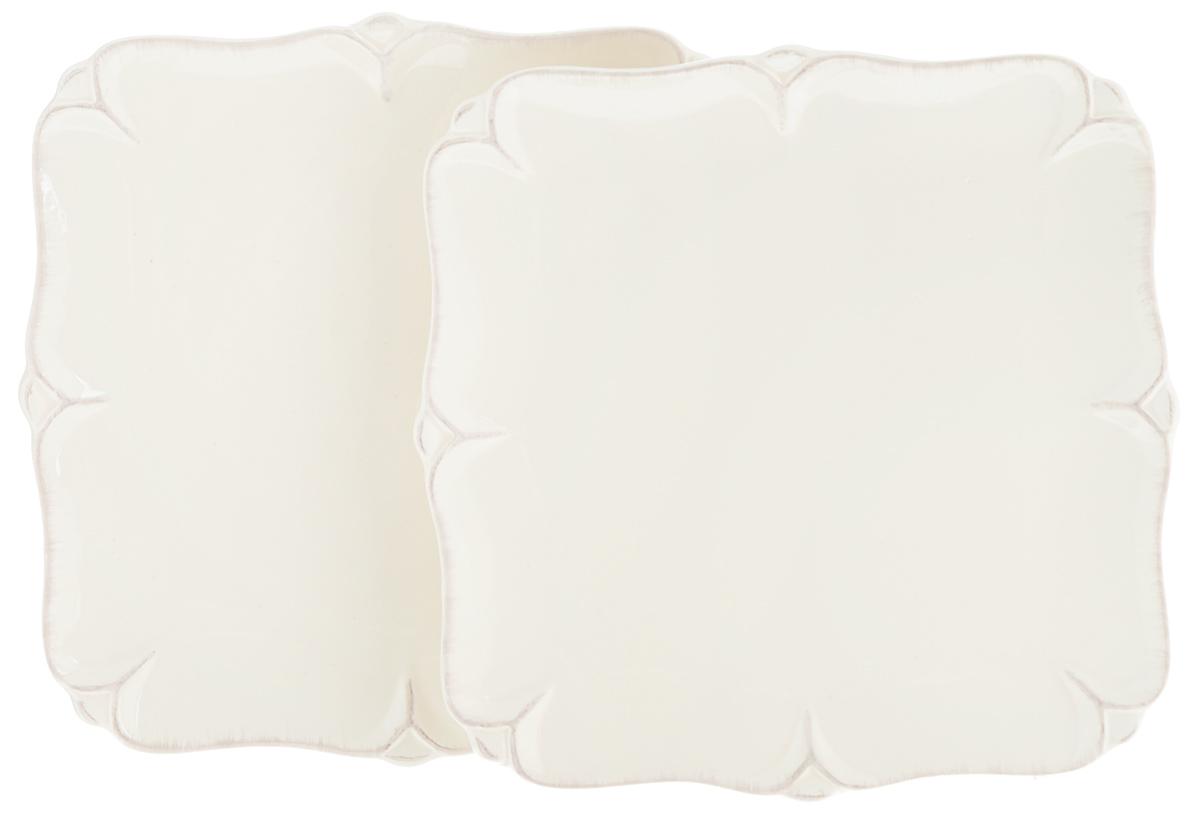 Набор тарелок Lillo Ideal, 20 х 20 см, 2 шт54 009312Набор Lillo Ideal состоит из 2 квадратных тарелок, выполненных из керамики. Изделия предназначены для красивой сервировки различных блюд.Набор сочетает в себе стильный дизайн с максимальнойфункциональностью. А оригинальность оформления придется по вкусу и ценителям классики, и тем, кто предпочитаетутонченность и изящность.Размер тарелки: 20 х 20 х 2 см.