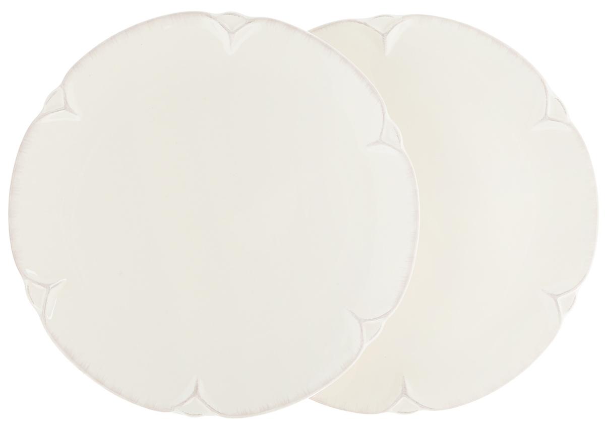 Набор тарелок Lillo Ideal, диаметр 22,5 см, 2 шт115510Набор Lillo Ideal состоит из 2 круглых тарелок, выполненных из керамики. Изделия предназначены для красивой сервировки различных блюд.Набор сочетает в себе стильный дизайн с максимальнойфункциональностью. А оригинальность оформления придется по вкусу и ценителям классики, и тем, кто предпочитаетутонченность и изящность.Диаметр тарелки: 22,5 см.Высота тарелки: 2 см.