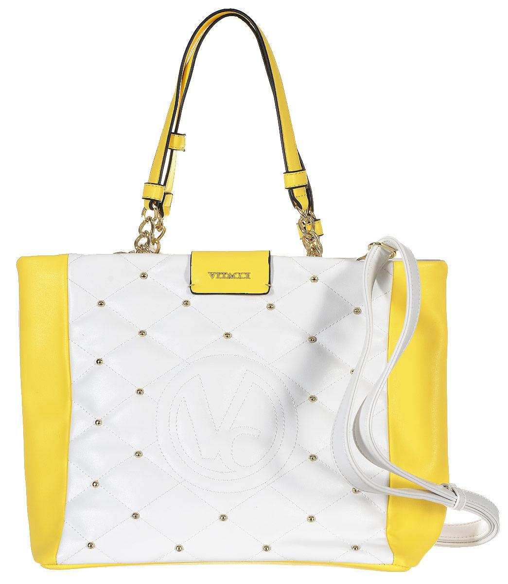 Сумка женская Vitacci, цвет: белый, желтый. 63505-523008Изысканная женская сумка Vitacci из искусственной кожи, оформлена декоративной прострочкой и фурнитурой золотистого цвета. Сумка закрывается на замок-молнию. Ручки сумки комбинированные, состоят из оригинальной плетеной металлической цепочки и кожи. Внутри два глубоких отделения, разделенные карманом-средником на молнии. Вместительные внутренние отделения содержат два накладных кармана для телефона и мелких принадлежностей, а также врезной карман на молнии. Лицевая сторона украшена вышитым декоративным элементом с логотипом фирмы. Снаружи на задней стенке сумки размещен вшитый карман на молнии. Сумка оснащена съемным плечевым ремнем регулируемой длины, которые позволят носить изделие как в руках так и на плече. Роскошная сумка внесет элегантные нотки в ваш образ и подчеркнет ваше отменное чувство стиля.