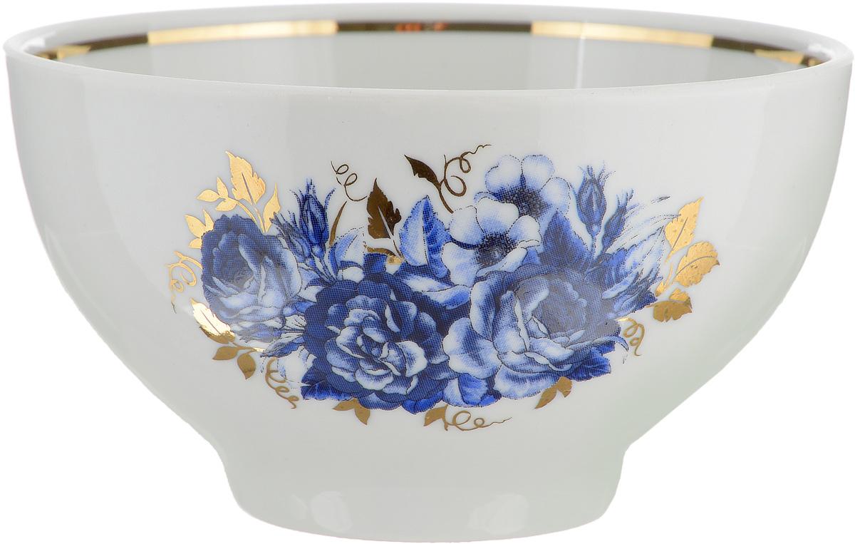 Пиала Синяя роза, 330 мл508045Пиала Синяя роза изготовлена из высококачественного фарфора. Внешняя стенка оформлена красочным изображением, а внутренняя - золотистым кантом. Изделие прекрасно подойдет для подачи салата или мороженого. Благодаря изысканному дизайну такая пиала станет бесспорным украшением вашего стола. Она дополнит коллекцию кухонной посуды и будет служить долгие годы. Диаметр пиалы по верхнему краю: 12 см. Диаметр основания: 5 см.