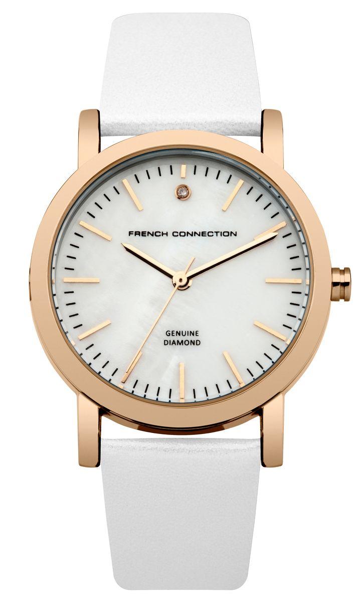 Часы наручные женские French Connection FC, цвет: белый. FC1250WRGBM8434-58AEСтильные часы French Connection FC - это модный и практичный аксессуар, который не только выгодно дополнит ваш наряд, но и будет незаменим для каждой современной девушки, ценящей свое время. Корпус выполнен из нержавеющей стали. Перламутровый циферблат оформлен логотипом бренда и украшен инкрустацией натуральным бриллиантом.Корпус изделия имеет степень влагозащиты 3 Bar, оснащен кварцевым механизмом и дополнен устойчивым к царапинам минеральным стеклом. Изысканный ремешок выполнен из натуральной кожи и дополнен пряжкой, которая позволяет с легкостью снимать и надевать изделие.Часы поставляются в фирменной упаковке.Часы French Connection подчеркнут изящество ваших рук и ваш неповторимый стиль и элегантность.