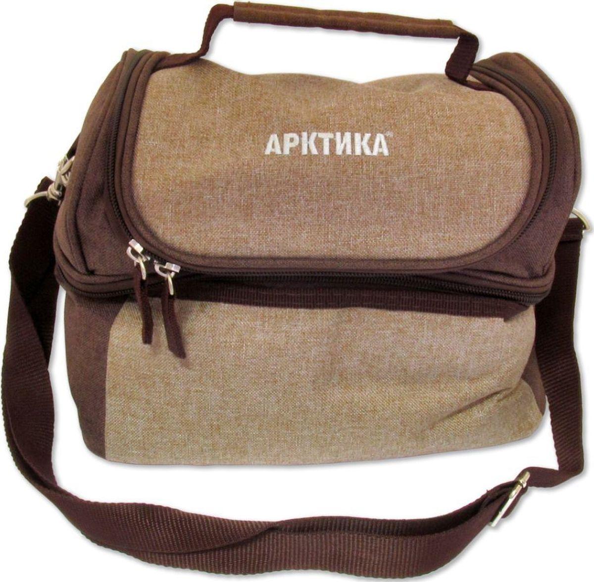 Сумка-холодильник Арктика, цвет: кофейный6.295-875.0Ланч-сумка незаменима для тех, кто следит за собственным рационом, и предпочитает всегда иметь при себе дневной запас провианта, а также все необходимые приборы. Решение от компании «Арктика» является воплощением стиля, эргономичности и практичности. Верх сумки выполнен из качественного полиэстера, а внутренняя отделка — с помощью специального изотермического материала. Изделие позволяет сохранять первоначальную температуру пищи в течение длительного времени, а также имеет удобные крепления для хранения приборов