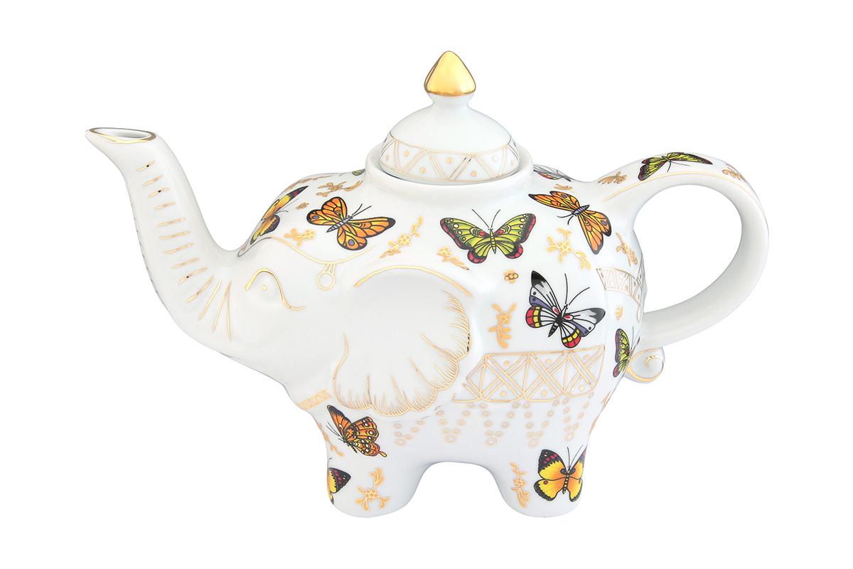 Чайник заварочный Elan Gallery Бабочки, 750 мл115510Оригинальный заварочный чайник Elan Gallery Павлин синий изготовлен из высококачественной керамики. Изделие декорировано красочным рисунком и золотистой эмалью. Чайник снабжен удобной ручкой и широким носиком. Загадочная страна Индия: чай, слоны, солнце, праздник! Чайник, выполненный в форме слона, будет напоминать вам об Индии и наполнит ваш дом солнечным настроением.Объем чайника: 750 мл.