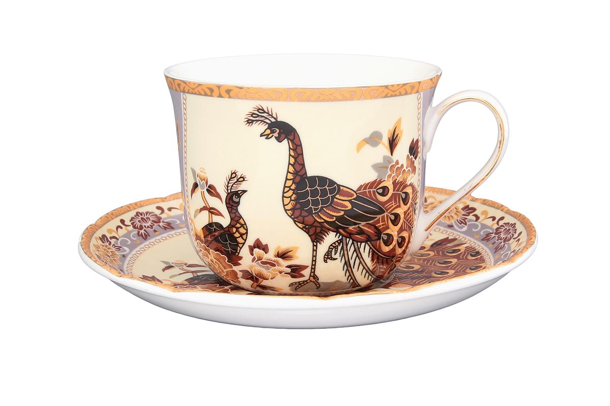 Чайная пара Elan Gallery Павлин на бежевом, 2 предмета115510Чайная пара Elan Gallery Павлин на бежевом состоит из чашки и блюдца, изготовленных из керамики высшего качества. Яркий дизайн, несомненно, придется вам по вкусу.Чайная пара Elan Gallery Павлин на бежевом украсит ваш кухонный стол, а также станет замечательным подарком к любому празднику.Не рекомендуется применять абразивные моющие средства. Не использовать в микроволновой печи.Объем чашки: 400 мл.