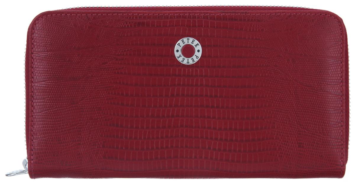 Портмоне женское Petek 1855, цвет: красный. 397/2.041.10BM8434-58AEСтильное женское портмоне Petek 1855 изготовлено из натуральной кожи с тиснением под рептилию. Портмоне закрывается на застежку-молнию.Внутри находятся два отделения для купюр, между которыми расположен карман на застежке-молнии для мелочи, двенадцать кармашков для визиток и пластиковых карт и два потайных кармана. Портмоне упаковано в фирменную коробку.Такое портмоне станет замечательным подарком человеку, ценящему качественные и практичные вещи.