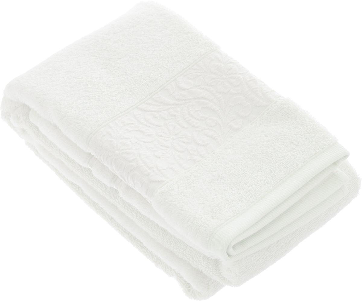 Полотенце бамбуковое Issimo Home Valencia, цвет: белый, 70 x 140 см391602Полотенце Issimo Home Valencia выполнено из 60% бамбукового волокна и 40% хлопка. Таким полотенцем не нужно вытираться - только коснитесь кожи - и ткань сама все впитает. Такая ткань впитывает в 3 раза лучше, чем хлопок.Несмотря на высокую плотность, полотенце быстро сохнет, остается легкими даже при намокании.Изделие имеет красивый жаккардовый бордюр, оформленный цветочным орнаментом. Благородные, классические тона создадут уют и подчеркнут лучшие качества махровой ткани, а сочные, яркие, летние оттенки создадут ощущение праздника и наполнят дом энергией. Красивая, стильная упаковка этого полотенца делает его уже готовым подарком к любому случаю.