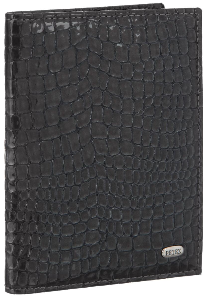 Обложка для автодокументов Petek 1855, цвет: угольный. 584.091.26595.46BD.10 RedОбложка для автодокументов Petek 1855 выполнена из высококачественной натуральной кожи с тиснением под крокодила. На внутреннем развороте - съемный блок из шести прозрачных файлов из мягкого пластика, один из которых формата А5, два боковых кармана, один из которых сетчатый, и четыре прорезных кармашка для визиток и пластиковых карт. Обложка не только поможет сохранить внешний вид ваших документов и защитит их от повреждений, но и станет стильным аксессуаром, который подчеркнет ваш неповторимый стиль.