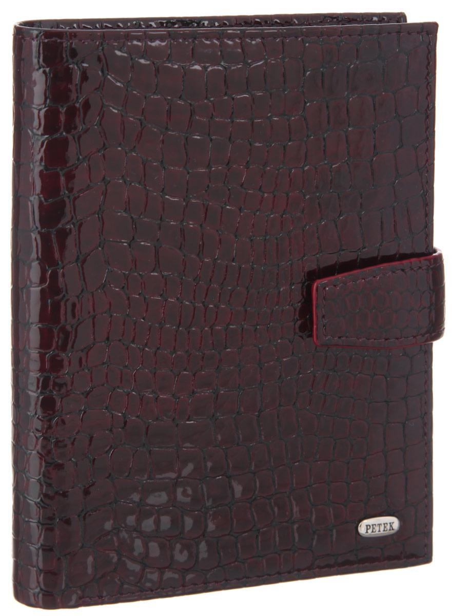 Обложка для паспорта и автодокументов Petek 1855, цвет: бургундия. 596.091.03AUTOZAM379Обложка для паспорта и автодокументов Petek 1855 выполнена из натуральной лакированной кожи с тиснением под рептилию. Внутри имеет отделение для паспорта, два боковых сетчатых кармана и съемный блок из шести прозрачных файлов из мягкого пластика, один из которых формата А5. Обложка закрывается на хлястик с кнопкой.Обложка упакована в фирменную коробку. Изделие сочетает в себе классический дизайн и функциональность. Обложка не только поможет сохранить внешний вид ваших документов и защитит их от повреждений, но и станет стильным аксессуаром, который подчеркнет ваш неповторимый стиль.