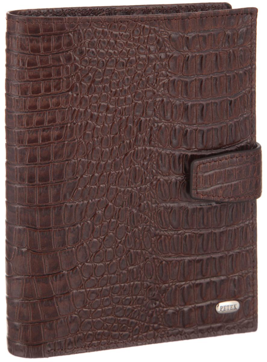 Обложка для паспорта и автодокументов Petek 1855, цвет: темно-коричневый. 596.067.02INT-06501Обложка для паспорта и автодокументов Petek 1855 выполнена из натуральной высококачественной кожи с тиснением под крокодила. Внутри имеет отделение для паспорта, два сетчатых боковых кармана и съемный блок из шести прозрачных файлов из мягкого пластика, один из которых формата А5. Обложка закрывается на хлястик с кнопкой.Обложка упакована в фирменную коробку. Изделие сочетает в себе классический дизайн и функциональность. Обложка не только поможет сохранить внешний вид ваших документов и защитит их от повреждений, но и станет стильным аксессуаром, который подчеркнет ваш неповторимый стиль.