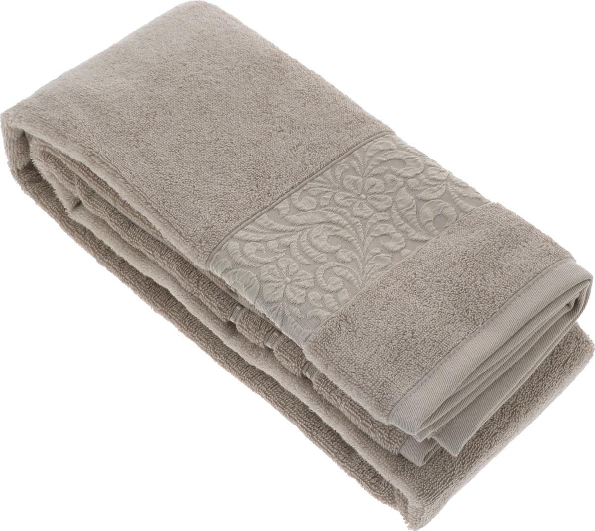 Полотенце бамбуковое Issimo Home Valencia, цвет: бежевый, 90 x 150 см97775318Полотенце Issimo Home Valencia выполнено из 60% бамбукового волокна и 40% хлопка. Таким полотенцем не нужно вытираться - только коснитесь кожи - и ткань сама все впитает. Такая ткань впитывает в 3 раза лучше, чем хлопок.Несмотря на высокую плотность, полотенце быстро сохнет, остается легкими даже при намокании.Изделие имеет красивый жаккардовый бордюр, оформленный цветочным орнаментом. Благородный, классический тон создаст уют и подчеркнет лучшие качества махровой ткани, а сочный, яркий, летний оттенок создаст ощущение праздника и наполнит дом энергией. Красивая, стильная упаковка этого полотенца делает его уже готовым подарком к любому случаю.
