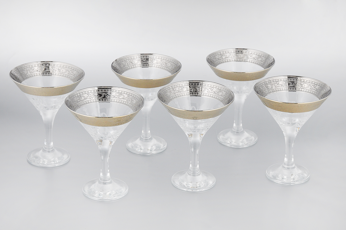 Набор бокалов для мартини Мусатов Венеция, 170 мл, 6 штVT-1520(SR)Набор Мусатов Венеция состоит из 6 бокалов, изготовленных из высококачественного стекла. Изделия оформлены оригинальной окантовкой и предназначены для подачи мартини. Такой набор прекрасно дополнит праздничный стол и станет желанным подарком в любом доме. Разрешается мыть в посудомоечной машине. Диаметр бокала (по верхнему краю): 10,7 см. Высота бокала: 13,7 см. Диаметр основания бокала: 6,5 см.