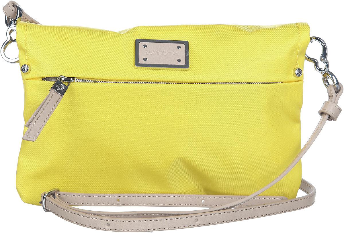 Сумка женская Samsonite, цвет: желтый. 22D-06012ML597BUL/DИзысканная женская сумка Samsonite выполнена из нейлона. Сумка закрывается на магниты. В раскрытом виде сумка с двух сторон содержит врезной карман на молнии. На лицевой стороне модель также оснащена врезным карманом на замке-молнии. Сумка имеет съемный плечевой ремень регулируемой длины, выполненный из искусственной кожи бежевого цвета. Спереди сумка декорирована металлической вставкой с эмблемой бренда.Практичная и стильная сумка прекрасно завершит ваш образ.