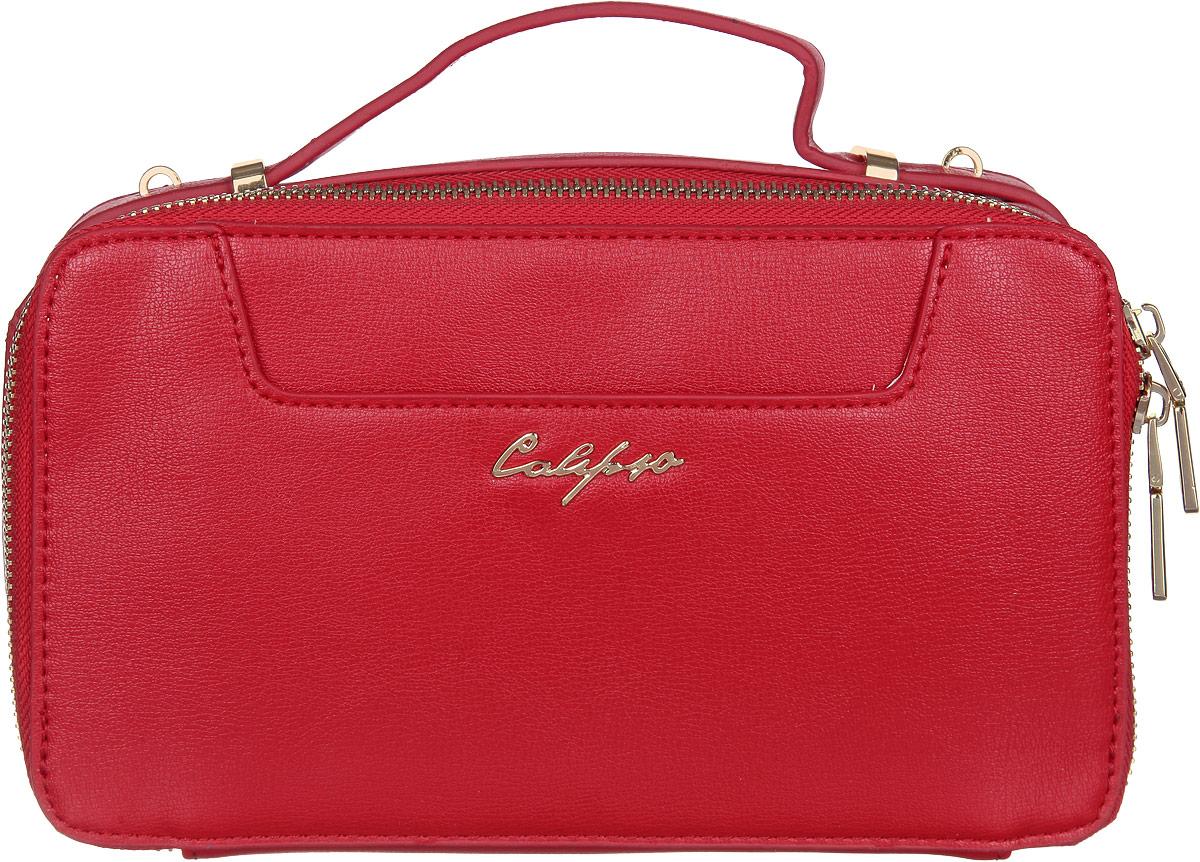 Сумка женская Calipso, цвет: красный. 817-041286-172L39845800Прелестная женская сумка Calipso выполнена из искусственной кожи. Изделие имеет одно основное отделение. Закрывается сумка на застежку-молнию. Внутри находятся карман на застежке-молнии и два накладных открытых кармана. Снаружи, на передней и задней стенках расположены накладные карманы, один из которых на магнитной кнопке. Модель оснащена одной удобной ручкой. В комплект входит съемный наплечный регулируемый ремень. Роскошная сумка внесет элегантные нотки в ваш образ и подчеркнет ваше отменное чувство стиля.