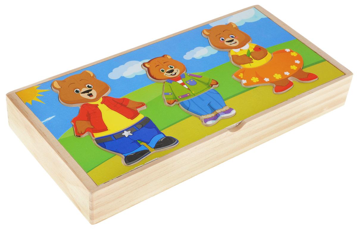 """С помощью деревянного пазла """"Три медведя"""" ваш ребенок без труда сможет собрать семью медведей. Пазл состоит из деревянных деталей, при помощи которых малыш сможет переодевать фигурки и менять эмоции в соответствии с настроением каждого мишки. Игра развивает мелкую моторику, логическое мышление, внимательность, сообразительность, знакомит малыша с разными эмоциями и деталями одежды, а также с понятием """"большой-маленький""""."""