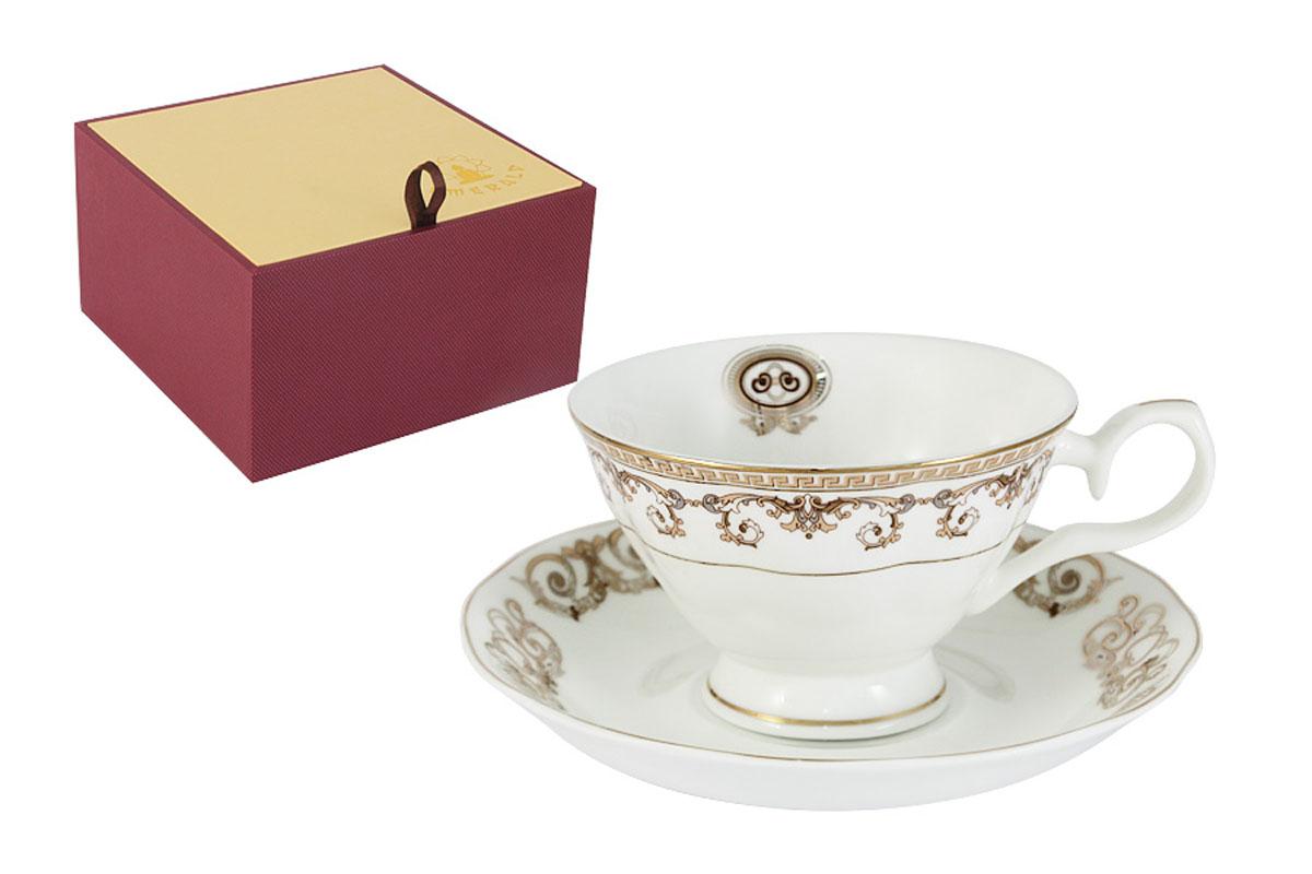 Чашка с блюдцем Emerald Версаче Золотой115510Чашка с блюдцем Emerald Версаче Золотой изготовлены из качественного костяного фарфора, декорированного изысканным золотым орнаментом. Поверхность изделий покрыта превосходной сверкающей глазурью, не содержащей свинца. Благодаря высокому качеству исполнения, разнообразным декорам и оптимальному соотношению цена-качество, посуда Emerald завоевала огромную популярность у покупателей и пользуется неизменно высоким спросом. Можно использовать в СВЧ. Не использовать в посудомоечной машине. Мыть с применением жидких моющих средств.Объем чашки: 200 мл.